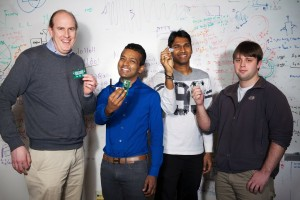 The team behind a University of Washington project to create a Wi-Fi powered display with a small device that can turn radio waves in the air into usable power. Show, from left, are Computer Science and Engineering professors Joshua Smith and Shyam Gollakota and graduate students Vamsi Talla and Bryce Kellogg.